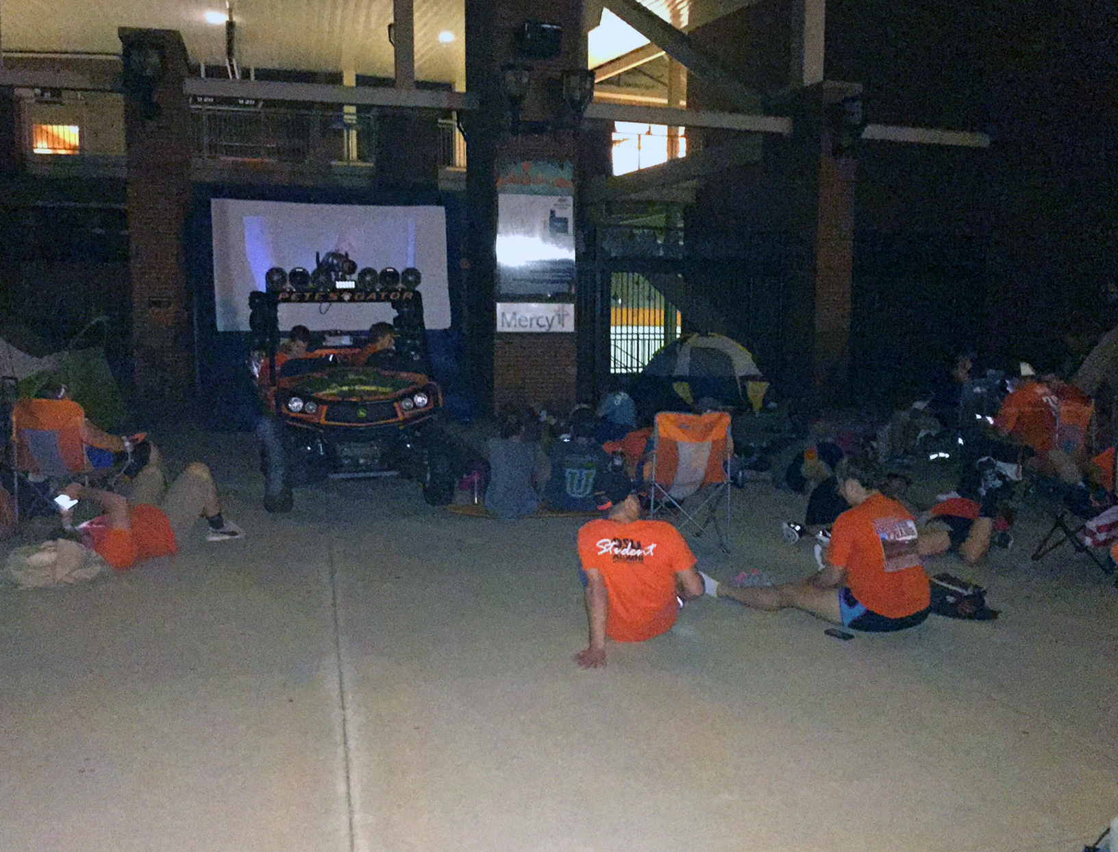 Campers watch a movie at a Rowdy campout.