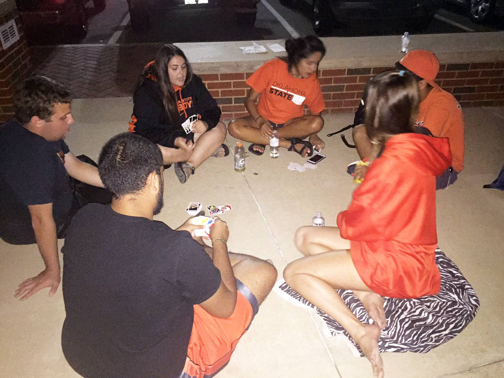 Campers play Uno at a Rowdy campout.